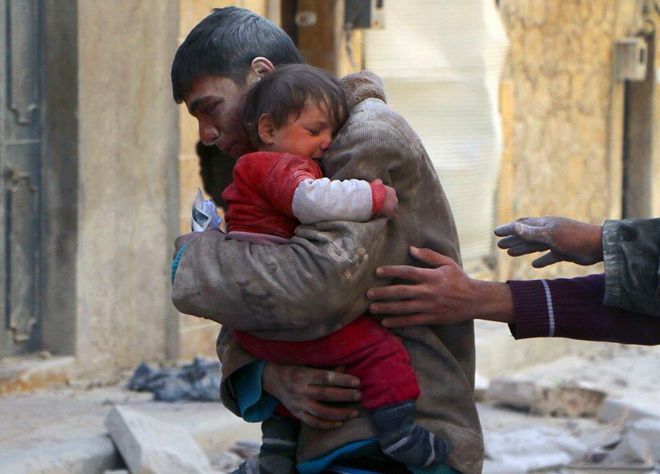 2. Young rescues his tiny sister in the rubble of his home in Syria
