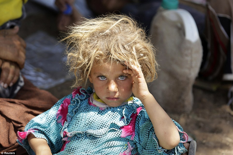 25. A girl Yazidi sect Minority lies on the border of Iraq and Syria Fishkhabour province of Dohuk after fleeing the island